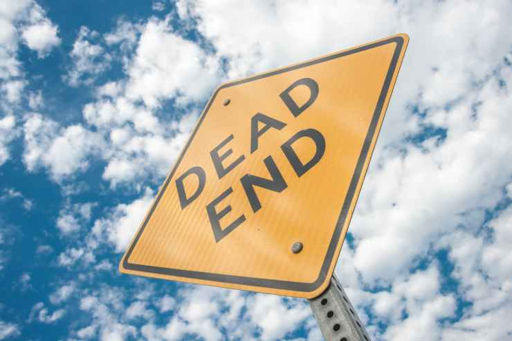yellow dead end sign during day time