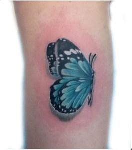 Tatuaggio farfalla blu e nera
