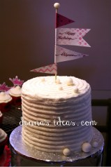flags and pennants on a rainbow layer cake