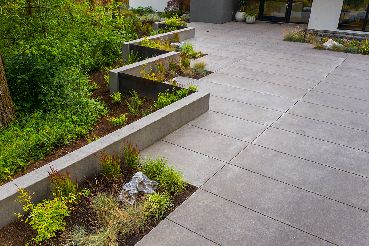 modern paver driveway with plants