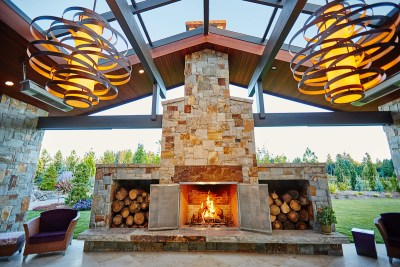 luxury stone fireplace in covered patio