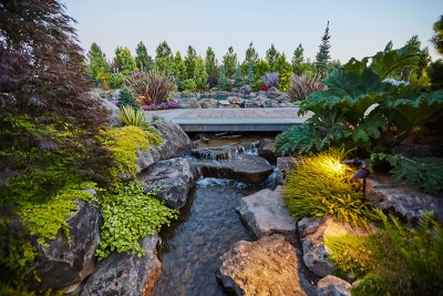 dream home with stream and bridge