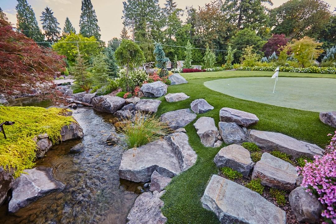 golf putting green along stream