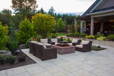 patio with fire pit in residential landscape
