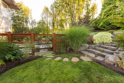 stone steps path and wood screen in landscape