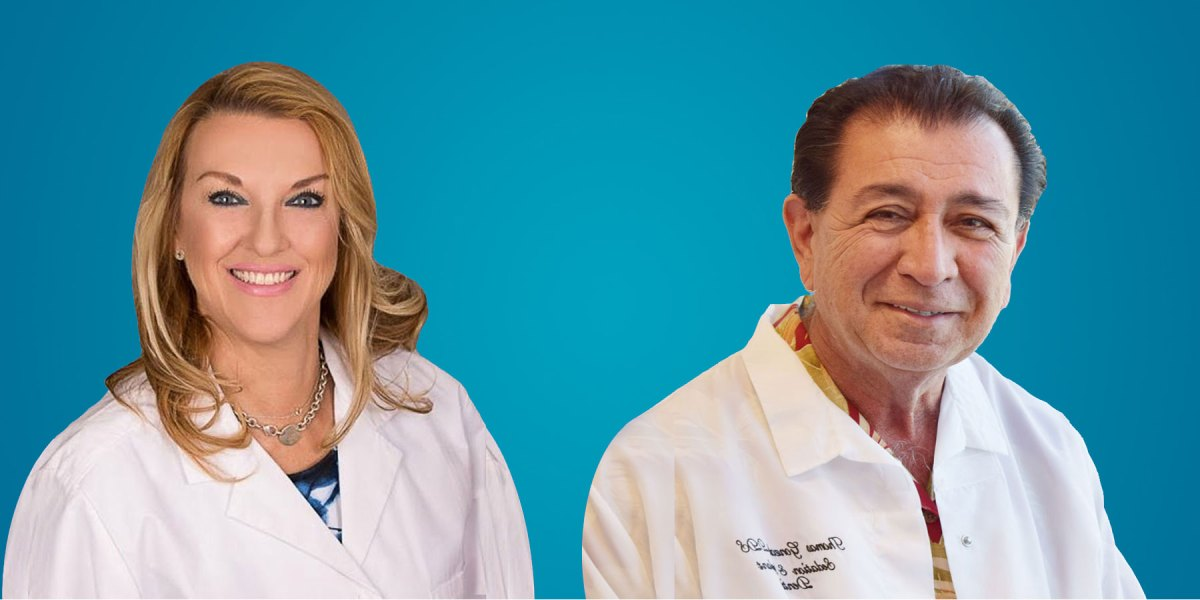 Female dentist and male dentist next to each other in white coats.