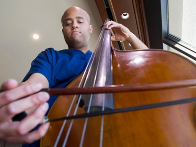 Talon Davis plays the double bass on the 17th floor of Roberts Hospital at Baylor University Medical Center at Dallas.