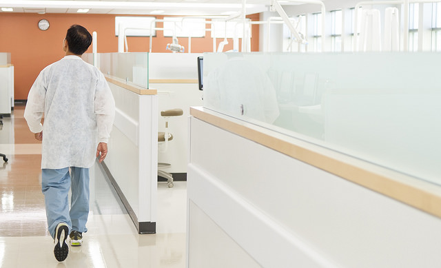 Dr. Don Le, Class of 1998, walks through the Urgent Care Clinic at the University of Texas School of Dentistry at Houston