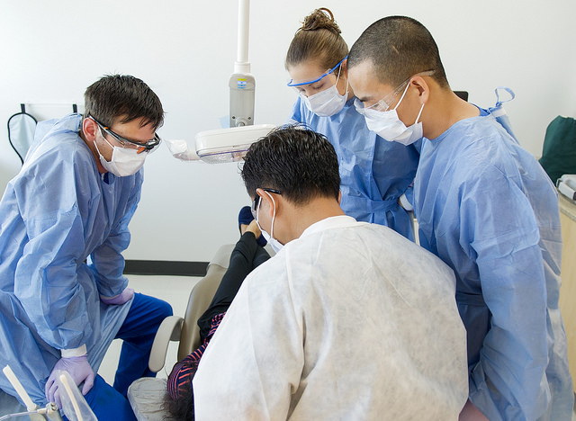 Dr. Don Le instructs students in the Urgent Care Clinic at the University of Texas School of Dentistry at Houston.