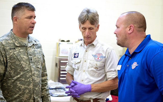 Brig. Gen. Sean Ryan converses with Ronnie Martin of Remote Area Medical, center