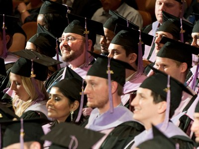 Graduates sit in their seats during commencement exercises on May 27 at the Morton H. Meyerson Symphony Center in Dallas