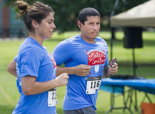 Alina Garciamendez-Rowold and Marcus Montalvo run at the June 27 Miles for Smiles Runathon.