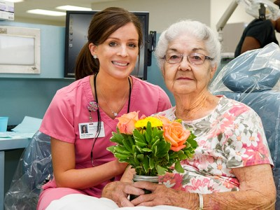 Third-year dental student Katie Freeman with patient Martha Seeber in the clinic