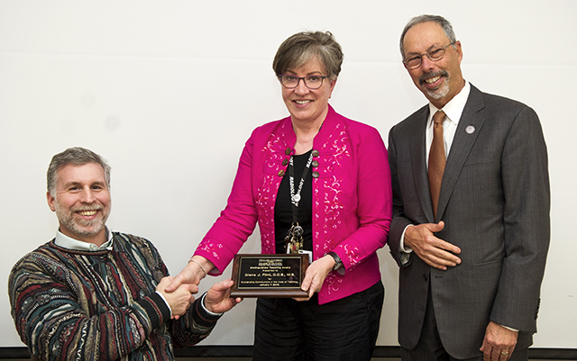 Left to right: Benson, Dr. Diane Flint, Wolinsky.