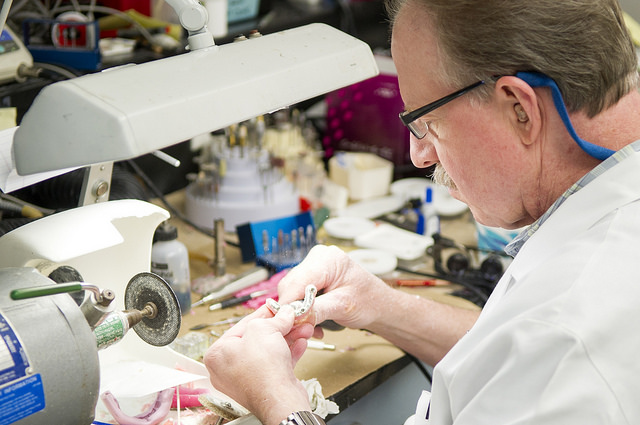 Steve Ruff works in the lab at the college's Center for Maxillofacial Prosthodontics