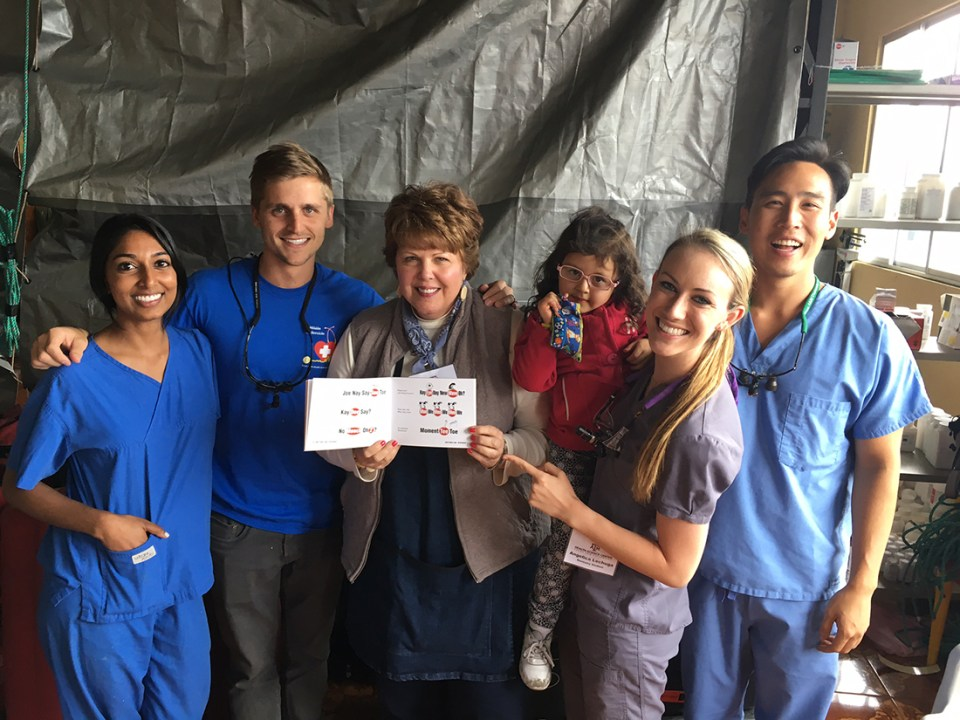 Group photo of College of Dentistry students and volunteers in Guamani, Ecuador