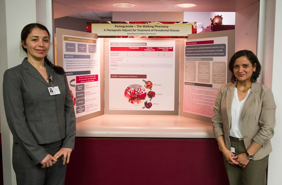 Iksaa Manzouri, left and Melina Ruiz-Alvarez with their table clinic findings during the April 5 Research Scholars Day at Texas A&M College of Dentistry