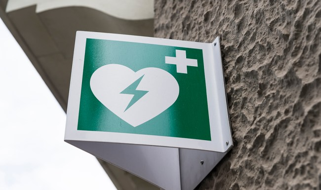 Automated External Defibrillator Emergency Sign Mounted on a Wall