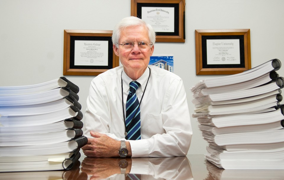 Dr. Charles Berry with accreditation self-study materials