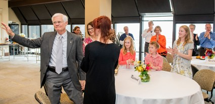Family, friends and colleagues join in honoring Dr. Charles Berry at his retirement reception.