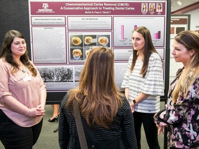 From left: Students Tina Tabrizi, Samantha Barkis and Candace Pope present their poster at Research Scholars Day.