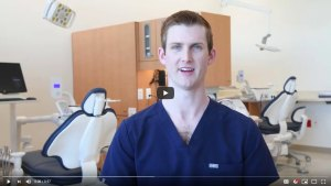 screenshot from video, dentistry student in blue in new clinic building