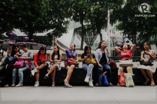 Overseas Filipino Workers, tourists, and Singaporeans relax on a Sunday afternoon along Orchard Road where many OFWs unwind during their day-off.