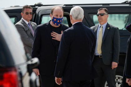 Governor Jared Polis, left, spoke with Vice President Mike Pence when he arrived at Peterson Air Force Base before giving his graduation address at the Air Force Academy on April 18, 2020 in Colorado Springs.