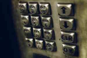 Pay phone dailer