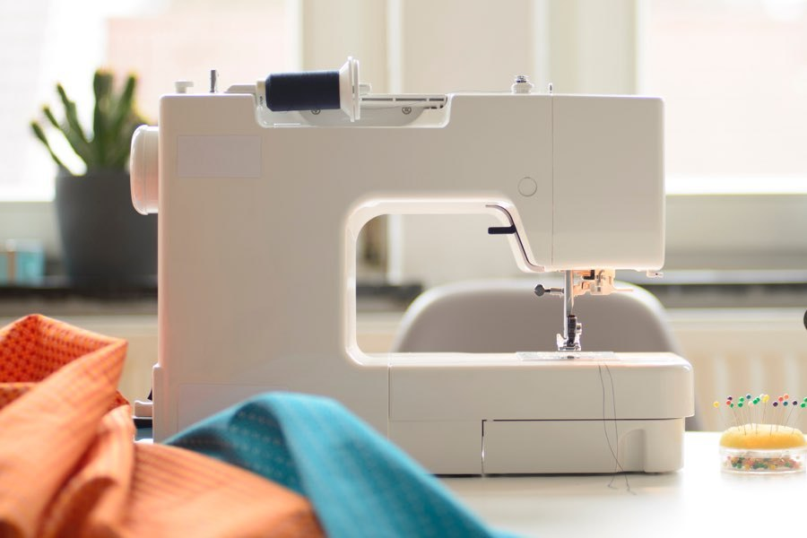 sewing machine repair with fabric in background