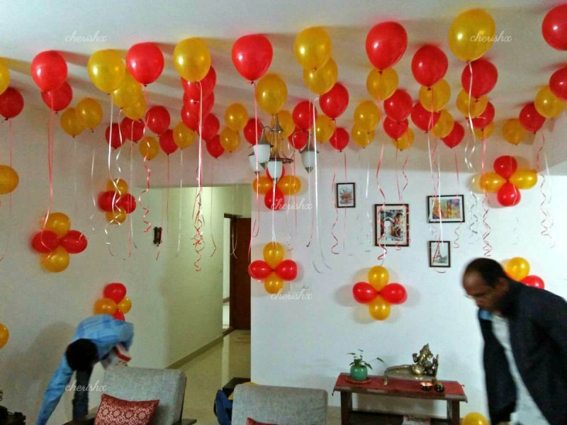 Balloon Decoration at Home in Delhi  Gurgaon  NCR   Balloon Surprise     Balloon decoration with hanging photos to celebrate your anniversary or  other events at home