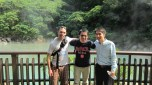 """Scott Polisky (BUS '12), Ying """"Robin"""" Tsou (MBA '11) and Eddie Lin at the Beitou Thermal Valley Green Sulfur Spring in Tapei, Taiwan."""