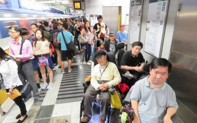 Electric Wheelchairs Face Challenges in Busy Hong Kong Public Transportation System