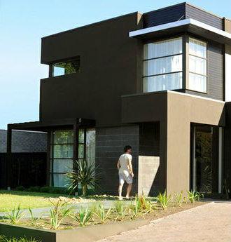 Casa moderna y formal de dos pisos cuatro dormitorios y for Casa de 2 plantas de 70 metros cuadrados