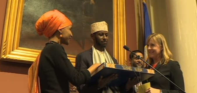 Ilhan Omar sworn into office with hand on quran