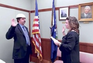 Politician sworn into office with a colander on his head
