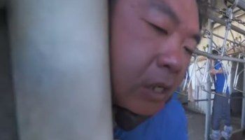 Close call for animal rights activist after chaining neck to duck slaughter line