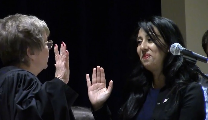 Muslim Woman Sworn into office on Quran, Torah, and Bible