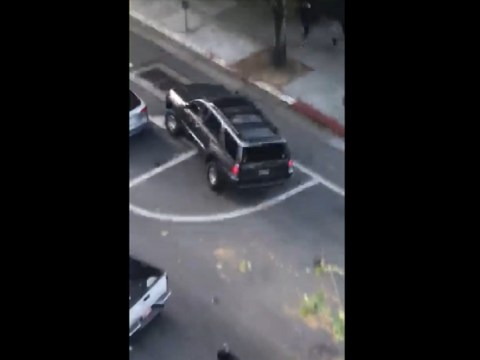 Video: Driver Plows Through Violent Rioters Blocking the Street