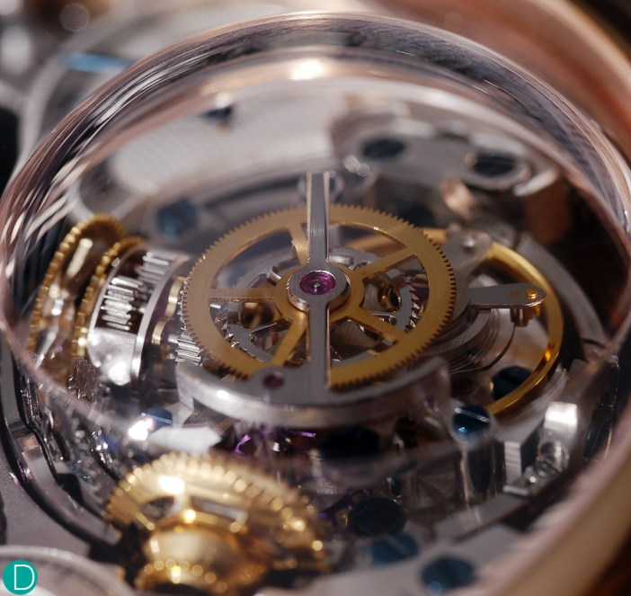 From the caseback, the gymbal anchor is visible. Also, the power transfer system from the mainspring is also visible.