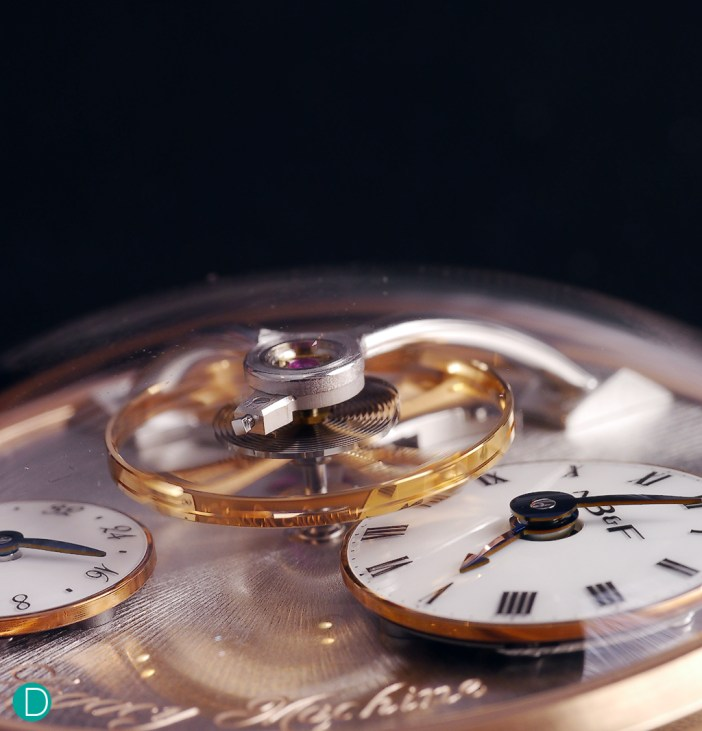 The large balance wheel, measuring 14mm in diameter, is suspended over the dial.