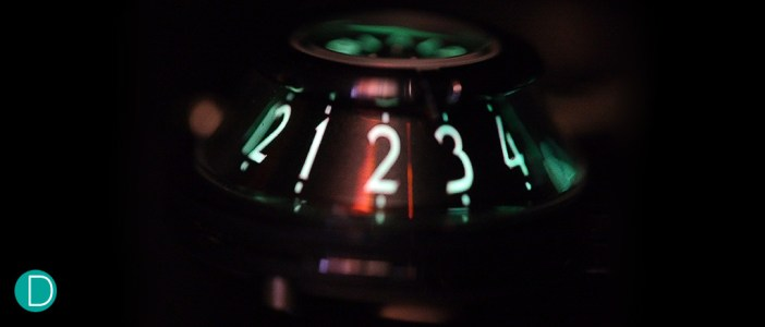 The lume: The trunkated cone of the hour dial is shown here, with the bright green glow of the Super LumiNova.