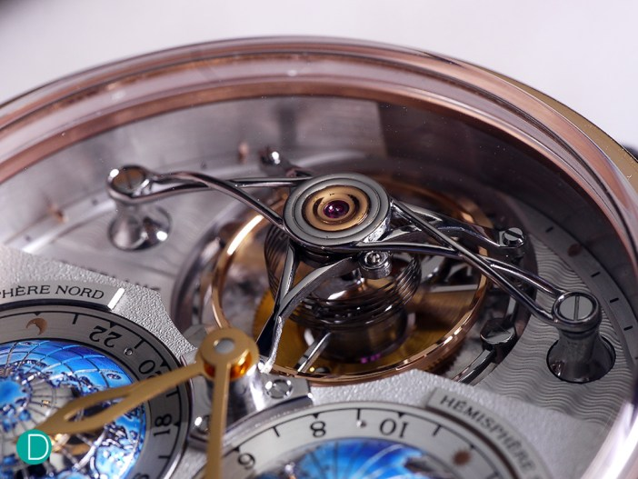 The tourbillon with a cylindrical hairspring and a very large balance wheel. The beautiful, arched curves of the tourbillon bridge is quite a spectacle.