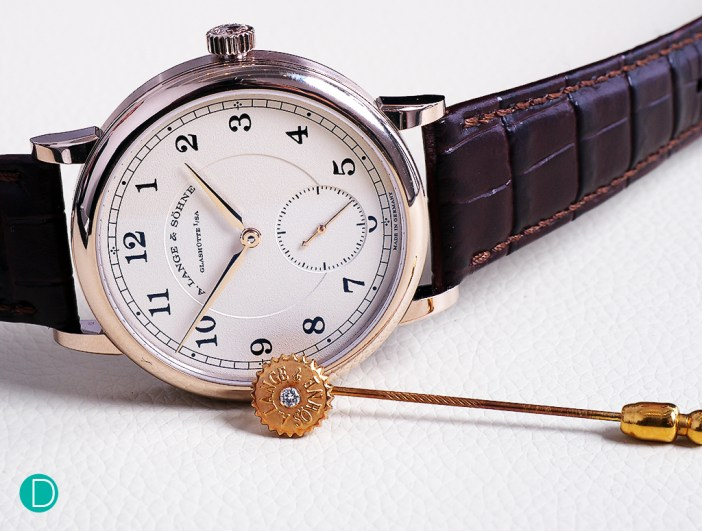 The Lange 1815 200th Anniversary F.A. Lange in honey coloured gold. The pin is in 18 k yellow gold, with a 15 year old patina. The pin is a piece unique, hand made by Master Engraver Helmut Wagner, and is made to resemble the crown of a Lange watch, and adorned with a diamond endstone used in Quality 1A Lange watches. The pin was presented by the late Günter Blümlein to the author in 1999.