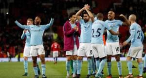 Pemain Manchester City merayakan kemenangan atau MU