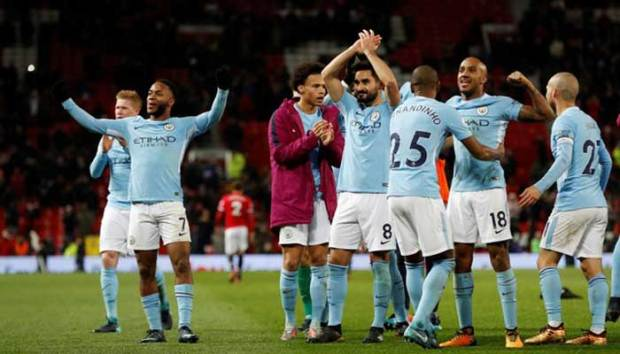 Pemain Manchester City merayakan kemenangan ats Manchaster United