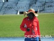 Equipo cubano de relevo 4x400 (Eloína Kerr, la preparadora)