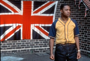 Young Soul Rebels photo showing Valentine Nonyela standing in front of a large Union flag