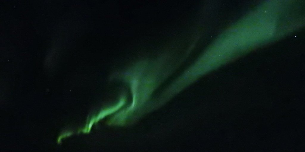 Aurora boreal frente a la costa de Varanger