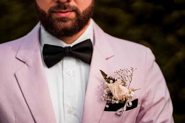 crop elegant male in pink jacket